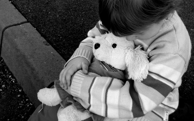 sad baby with teddy Bear